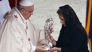 Floribeth Mora, who claims she was cured of a serious brain condition by a miracle attributed to late Pope John Paul II, presents his relic to Pope Francis