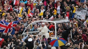 Pope Francis drives through St Peter's Square in the popemobile to meet the crowd