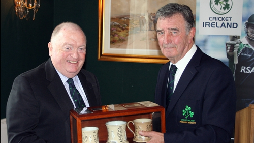 Joe Doherty receives the ceremonial Staffordshire Mugs from outgoing president Robin Walsh