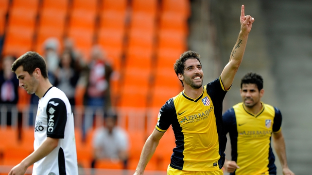 Atletico Madrid's Raul Garcia celebrates his winner against Valencia