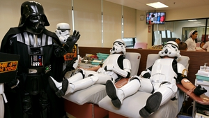 Thai Star Wars fans dressed as Darth Vader and Storm Troopers donate blood in Bangkok to celebrate the upcoming Star Wars Day with good deeds