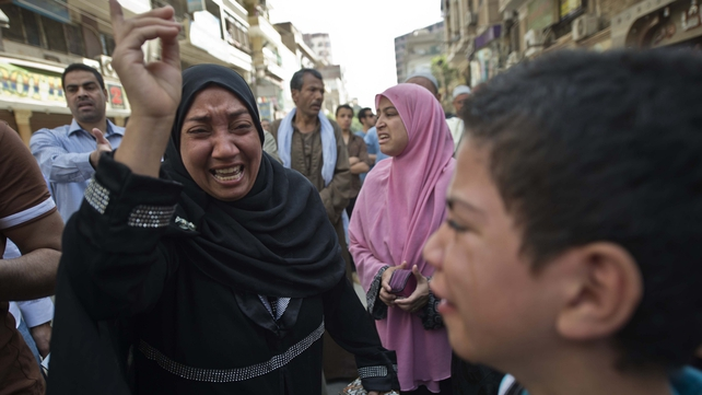 Egyptians react outside the courtroom in Minya after the death sentences were announced