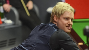 Neil Robertson reacts after missing the black for a century break against Mark Allen
