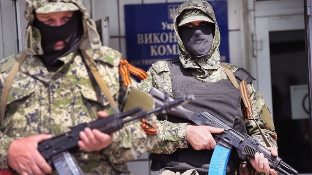Pro-Russian militants stand guard in the front of the city council building in Kostyantynivka