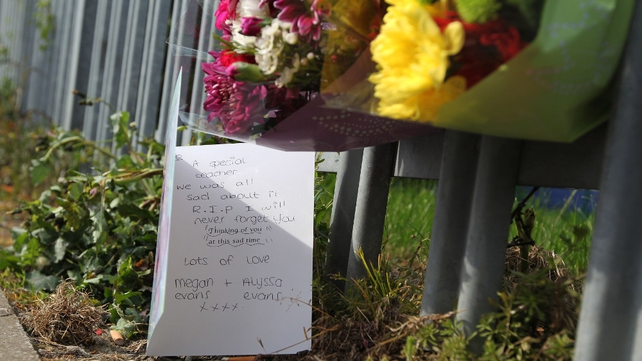 Flowers and cards are placed outside the school