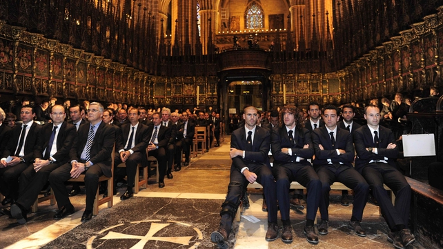 Barcelona players and officials gather during a religious ceremony for the late, former Barcelona coach Tito Vilanova