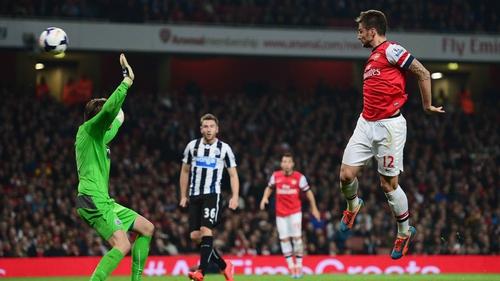 Olivier Giroud heads home Arsenal's third