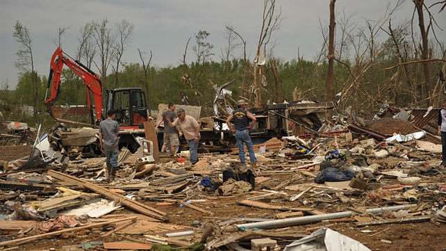 People recover items amid debris following the tornado in Mayflower, Arkansas