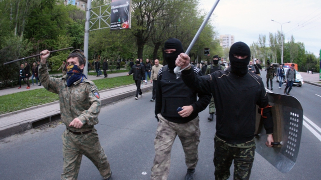 Pro-Russian separatists march through Donetsk