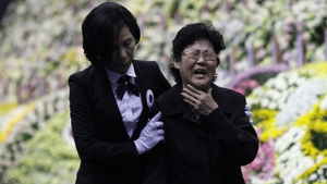 A woman weeps at a group memorial altar for victims of the sunken ferry