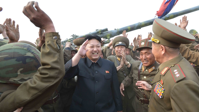 North Korean leader Kim Jong-un, seen in an undated photo, meets soldiers of a long-range artillery unit