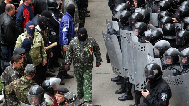 Separatists block Ukrainian riot police from entering the Regional Administration building in Luhansk