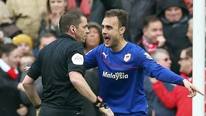 Cardiff Citys Juan Cala argues with referee Phil Dowd after receiving a red card