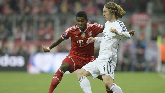 Alaba and Modric compete for the ball early in tonight's encounter