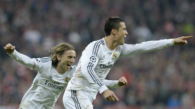 Cristiano Ronaldo (R) celebrates  scoring his second and Real Madrid's fourth goal