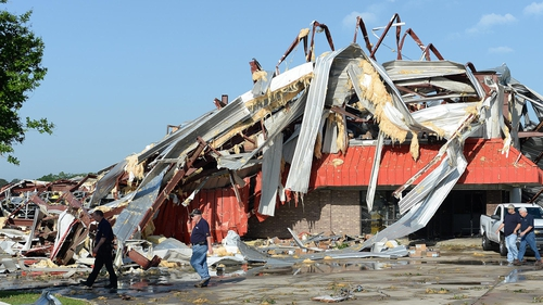 Insurance adjustors inspect what is left of the Fleet Pride Truck & Trailer Parts building in Richland, Mississippi