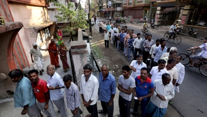Indian voters wait in line outside a polling station in Bengal during the third phase of the general election (Pic: EPA)