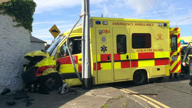 The ambulance collided with a car and then hit a wall