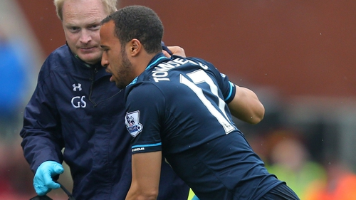 Andros Townsend is helped to the touchline during his side's game against Stoke