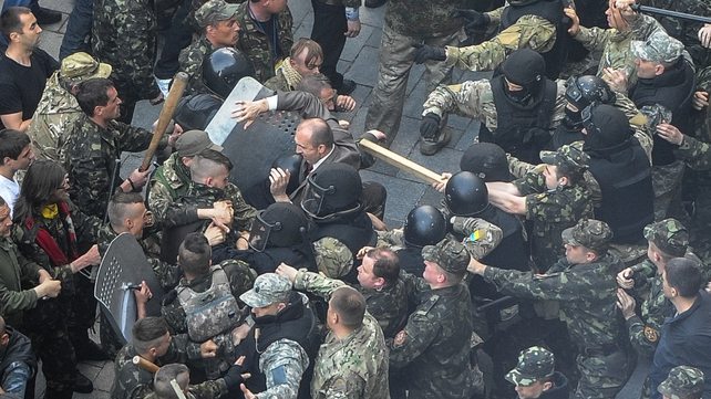 Ukrainian Maidan self-defence activists clash with special police, who are guarding the Cabinet of the Ministers building in Kiev