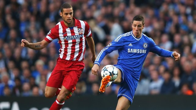 Mario Suarez Atletico Madrid keeps a close eye on Chelsea's Fernando Torres at Stamford Bridge