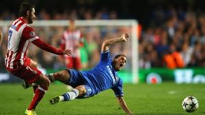 Eden Hazard is tackled by Adrian Lopez