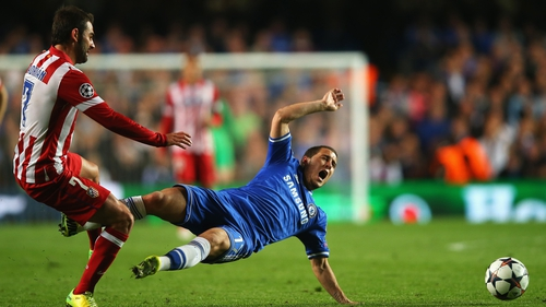 Eden Hazard is tackled by Adrian Lopez