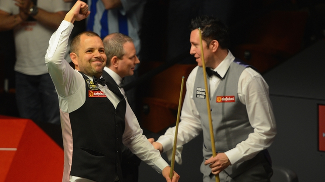 Barry Hawkins celebrates his narrow victory over Dominic Dale