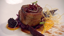 Bacon wrapped loin of venison with red cabbage, butternut squash puree and beetroot