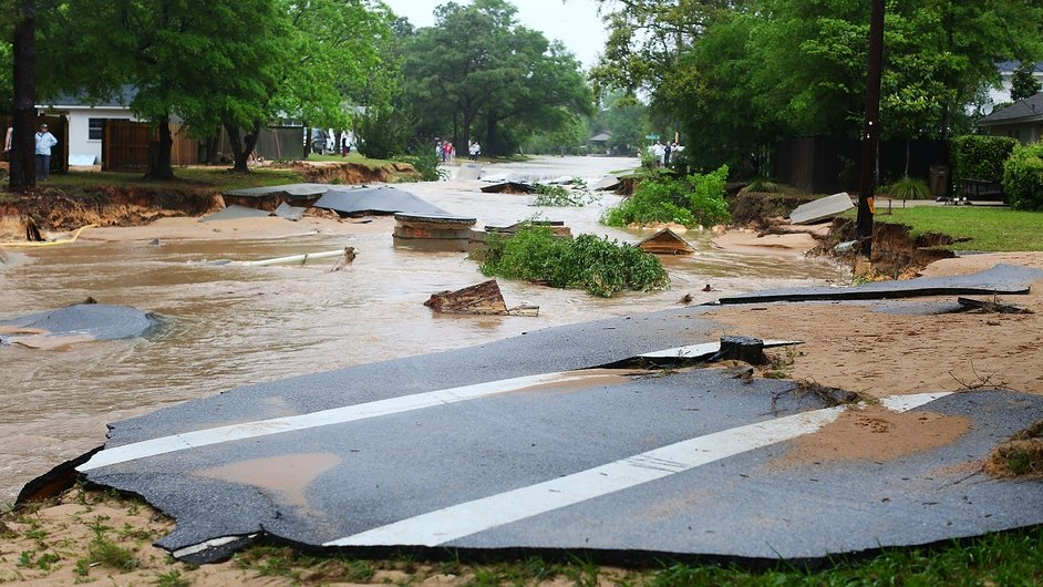 A road is washed away in heavy rain in Pensacola, Florida