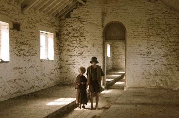 A reconstructed image of children arriving at a workhouse