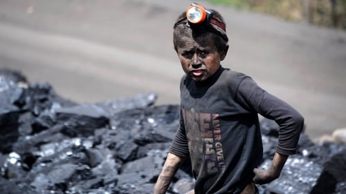A young boy works at a coal mine in Afghanistan, where a collapse killed 40 workers earlier this week