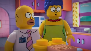 Homer and Marge transformed into Lego pieces