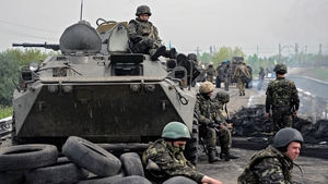Ukrainian troops take position at a checkpoint they seized in the early morning in the village of Andreevka near Slaviansk