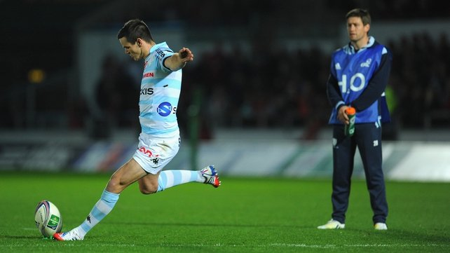 Ronan O'Gara watches on in his role as Racing Metro coach, as his former playing rival Johnny Sexton, kicks at goal