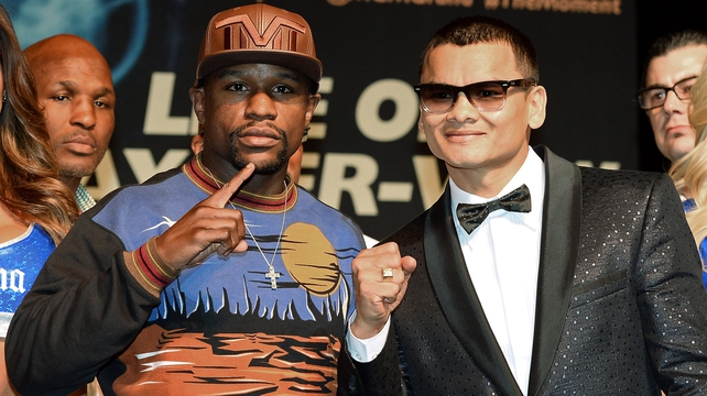 WBC welterweight champion Floyd Mayweather Jr and and WBA champion Marcos Maidana pose at the MGM Grand ahead of Saturday night's world title fight