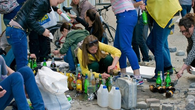 Women prepare Molotov cocktails during clashes in Odessa