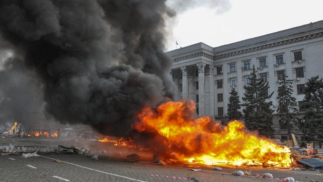 Ukrainian supporters of a 'Single Ukraine' burnt a tent camp of pro-Russian protesters in Odessa yesterday