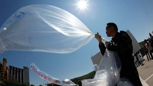 North Korean defectors prepare balloons set to be launched carrying anti-North Korea government propaganda leaflets with US dollars and DVDs into North Korea