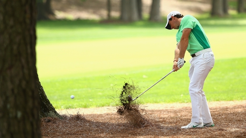 Rory McIlroy hits a shot on the third hole during the second round