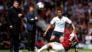 Kyle Naughton of Spurs is challenged by Matthew Taylor