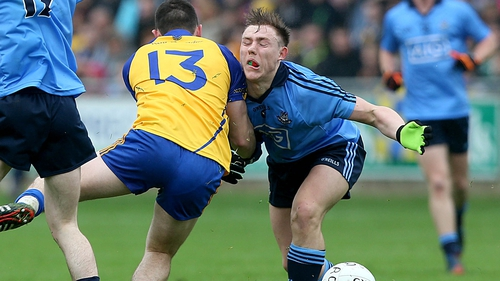 John Small of Dublin collides with Diarmuid Murtagh