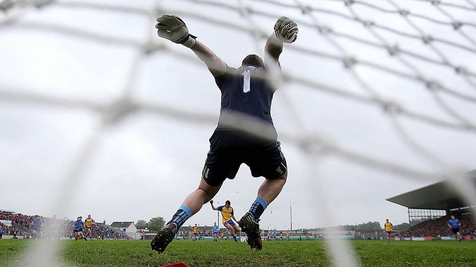 Dublin under-21 goalkeeper Lorcan Molloy saves a penalty from Donie Smith of Roscommon