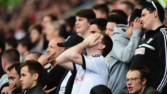 Fulham fans react as their side slumps to a relegation-ensuring defeat