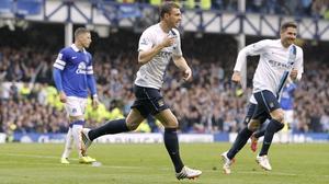 Manchester City's Edin Dzeko (C) celebrates scoring their third goal
