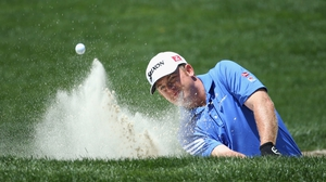 Holmes plays from a greenside bunker during the third round of the Wells Fargo Championship at Quail Hollow