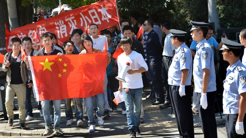 Anti-Japanese demonstrators march with the Chinese flag in a protest outside the Japanese Embassy in recent years