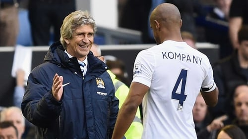 Manuel Pellegrini congratulates captain Vincent Kompany after the match