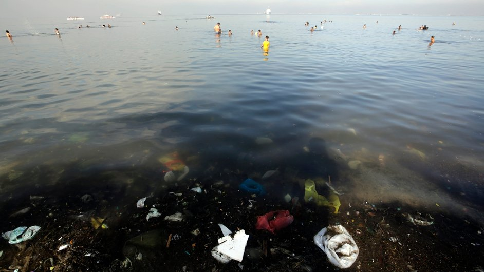 Filipinos swim in the polluted waters of Manila Bay to beat the scorching heat in Manila, Philippines