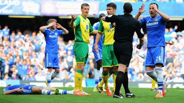 John Terry protests to referee Neil Swarbrick after Chelsea are denied a penalty